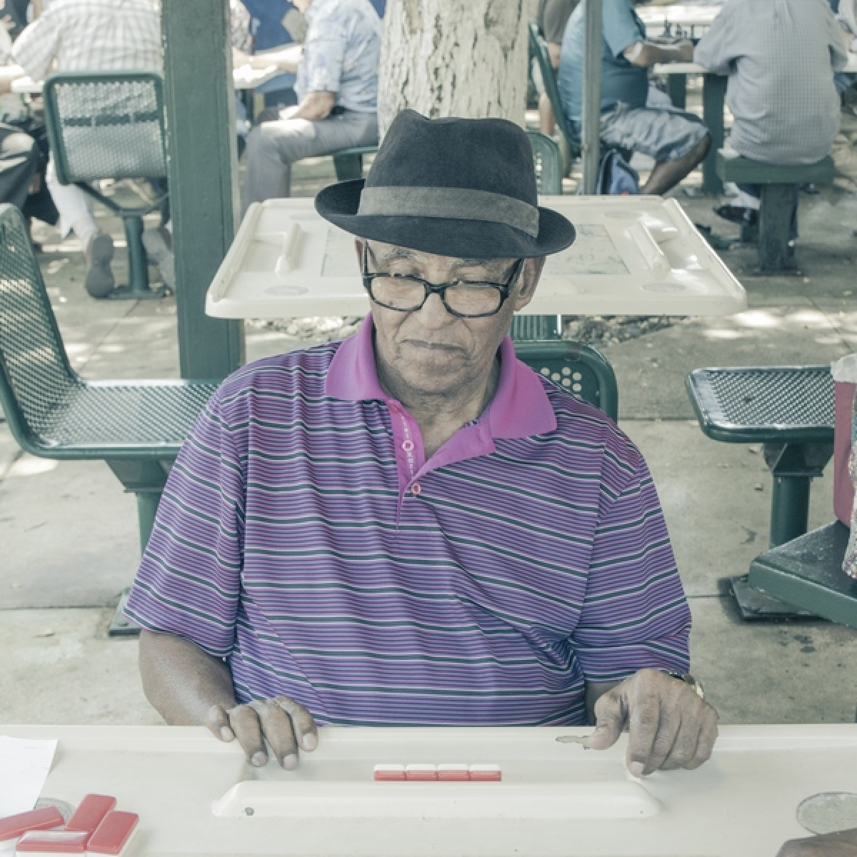 Elderly man playing board game outside