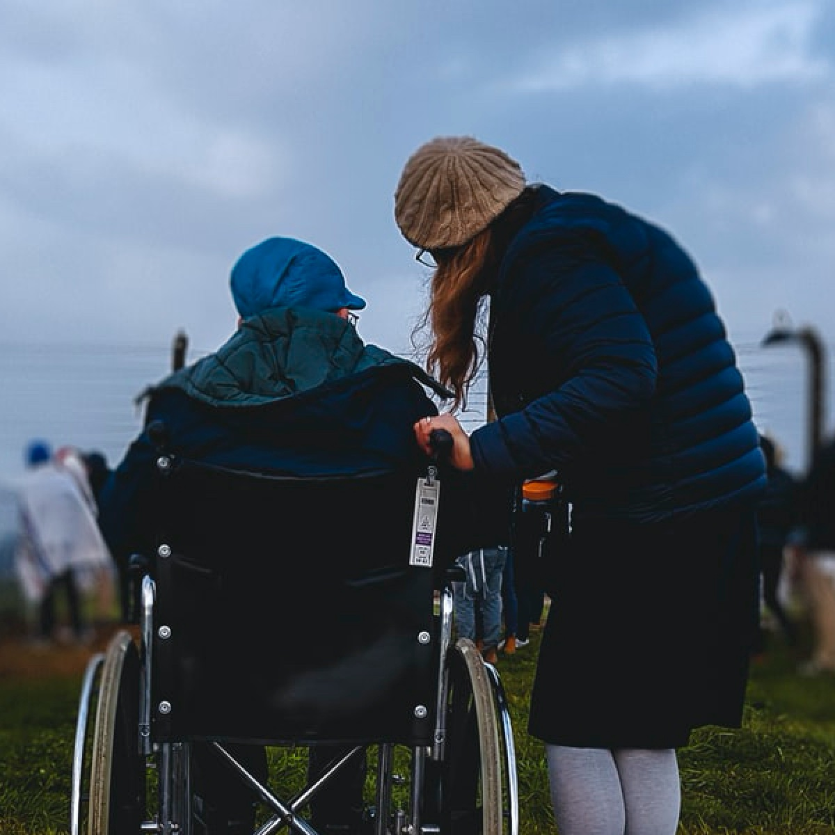 Lady speaking with person in wheelchair
