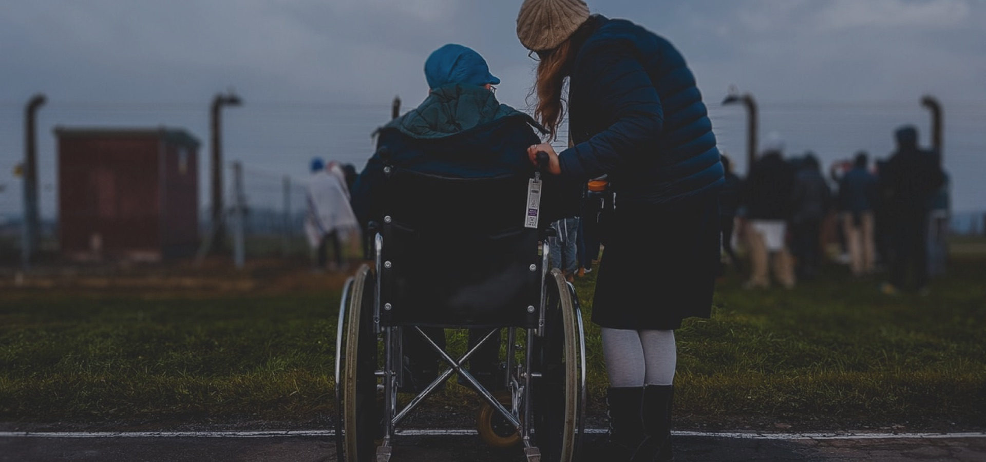 woman in wheelchair with caregiver
